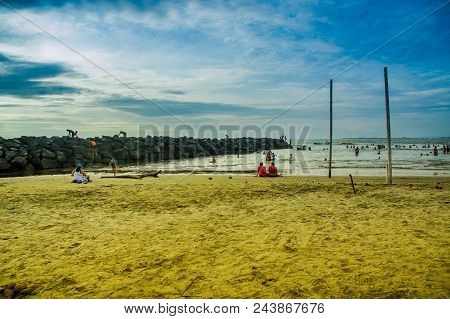 Manabi, Ecuador - May 29, 2018: Unidentified Tourists Enjoying The Beautiful Natural Landscape Of Co
