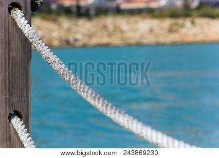 Rope handrails made of rope against the blue sea poster