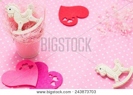 Pink Baby Girl Theme. 2 Rocking Ponies Toys In Pink Small Bucket With Straw And Felt Hearts Flat Lay