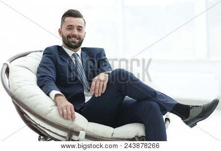 confident businessman sitting in a chair