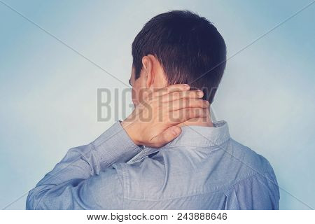 Man With Neck Pain. Concept Of Fatigue After Work. Businessman In Shirt On Blue Background. Tired Wo
