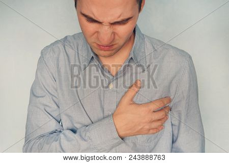 Man Having Heart Ache Holding Hand On Her Chest Heart Attack Or Stroke Health Care Concept. Mental P