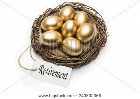 Nest With Golden Eggs With A Tag And A Word Retirement On A White Background. The Concept Of Success