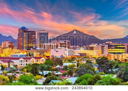 Tucson, Arizona, USA downtown skyline with Sentinel Peak at dusk. (Mountaintop