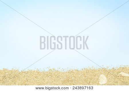 Sand On Cyan Paper Surface With Copy Space