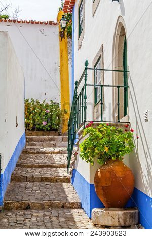 Obidos, Portugal. Typical medieval street. Obidos is a medieval town still inside the walls, and very popular among tourists.