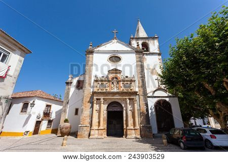 Obidos, Portugal. Medieval Santa Maria Church showing a Renaissance Portal. Obidos is a medieval town inside walls, and very popular among tourists.