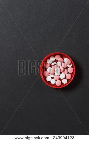 Medication White Colorful Round Tablets On Black Color Background. Aspirin, Pills For Design. Health