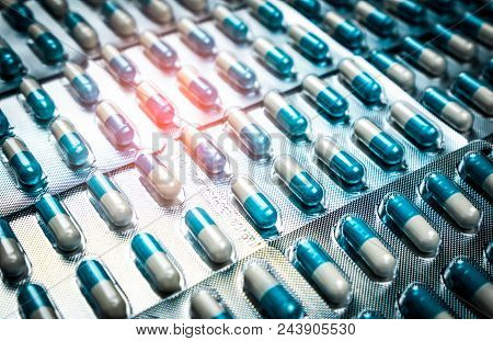 Blue And White Capsules Pill In Blister Pack Arranged With Beautiful Pattern. Global Healthcare Conc