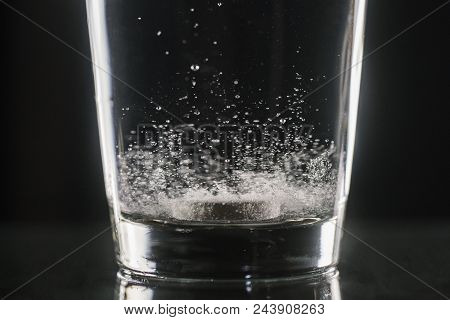 Closeup Of Painkiller Tablet In Glass Of Water. Vertical Shape, Copy Space