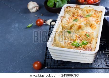 Delicious Homemade Lasagne With Ricotta Cheese And Spinach On Blue Stone Concreet Table Background.