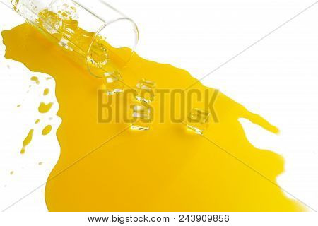 Spilled Glass Of Orange Juice With Ice Cubes On A White Background. Flat Lay, Top View.