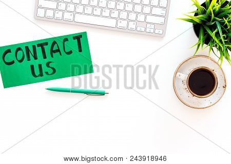 Frame Contact Us. Lettering Contact Us On Office Work Desk With Computer On White Background Top Vie