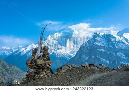 The Stone Stupa On The Background Of Snowy Mountains In The Himalayas, Nepal.