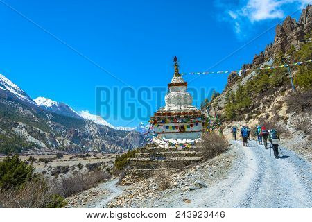 Tourists, And A Large Stone Stupa On A Mountain Road In The Himalayas, Nepal.