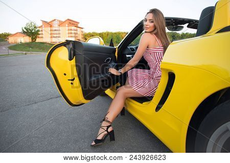 The Ideal Life! Smiling Tender Beautiful Young Sexy Woman Sitting On The Drivers Seat Of Her Yellow