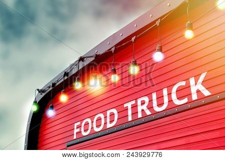 Detail Of Closed Red Food Truck With Light Bulb Background, No People