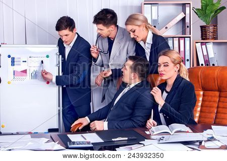 Business people office life of team people working with papers sitting table. Cabinets with folders and jalousie background. Schemas on presentation. Business strategy is most important factor.