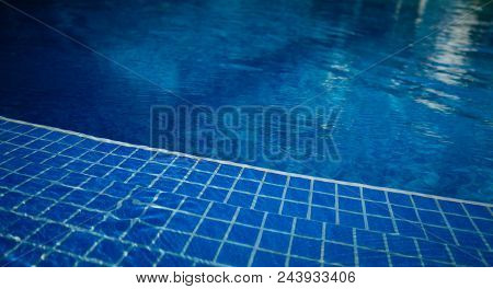 Clean Blue Water Of The Swimming Pool, Nobody. Swimming Pool Background.
