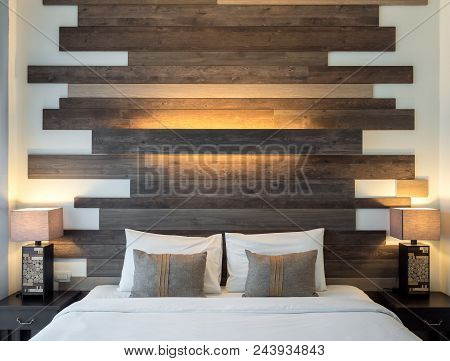 Empty Double Bed And Lamp On Wooden Table On Side Of Bed In Luxury And Natural Style Bedroom Is Deco