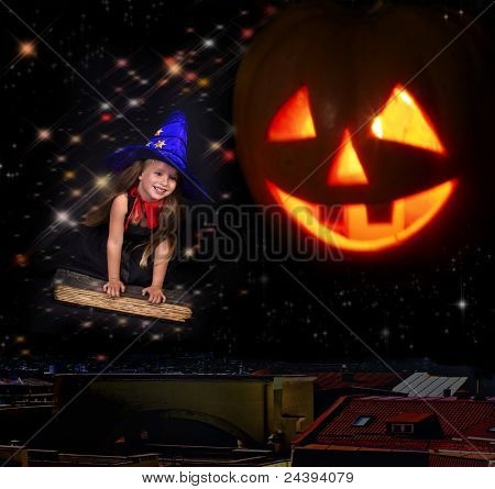 Witch child flying on  book. Halloween concept..