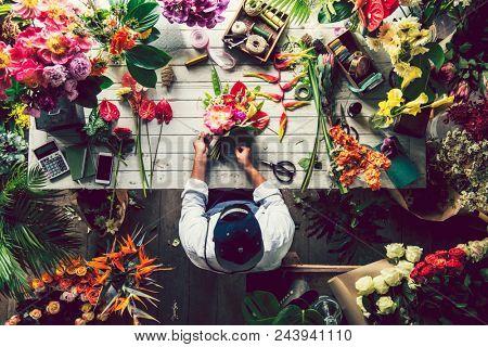 Florist making a flower arrangement