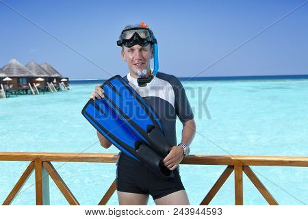The Sports Man In A Suit For A Snorkeling On Sundeck Of A House Over The Sea. Maldives