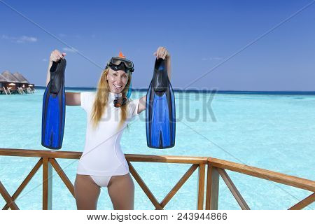 Young Beautiful Girl Stands In Pink Sundress On Sundeck Of Villa On Water, Maldives