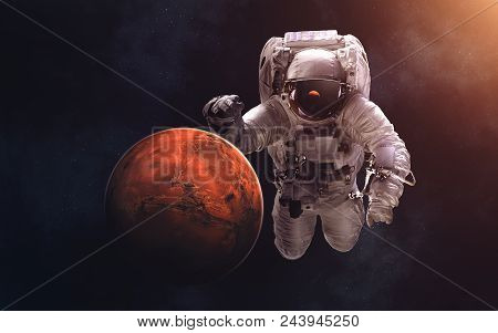 Mars And Giant Astronaut. Image In 5k Resolution For Desktop Wallpaper. Elements Of The Image Are Fu