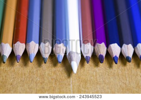 Black Lead Pencils Lie In A Row, One Pencil Has An Eraser On The End, Small Depth Of Sharpness