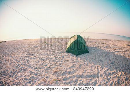 Tent On The Sea Coast. Camping On The Ocean Coast. Rest On The Sandy Beach.