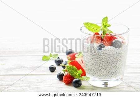Healthy Nutritious Vegan Superfood Dessert With Organic Berries And Chia Seeds With Different Servin