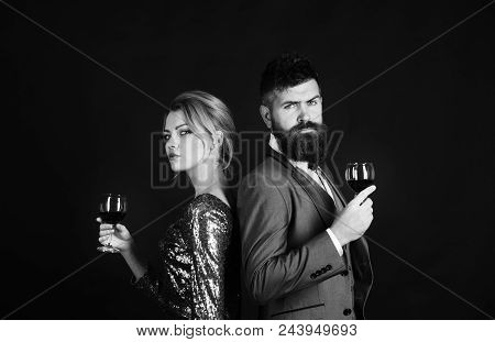 Red Wine. Lady And Gentleman With Serious Faces Tasting Italian Alcohol. Couple In Love Holding Glas