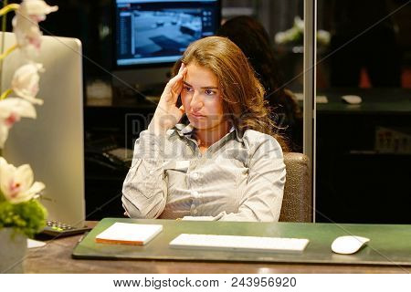 A Woman-reception Suffering From Headache Migraine Pain. Health Problem, Stress And Depression. Fema