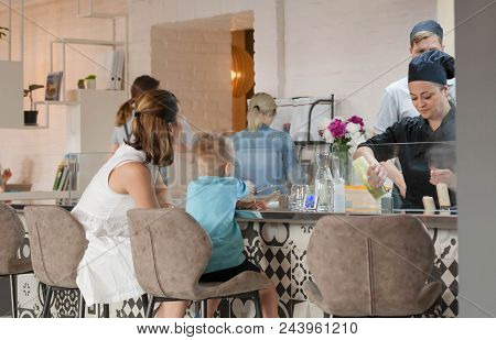 Kyiv, Ukraine - Jun 5: Cooking Chef Making Food At Open Kitchen For Child And Family Inside Modern R