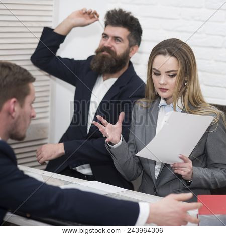 Business Negotiations, Discuss Working Tasks. Office Atmosphere Concept. Lady Manager Tries To Organ