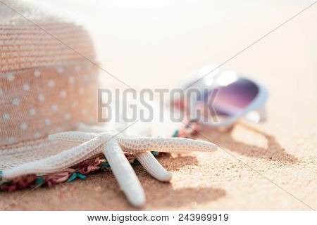 Soft Focus On Starfish. Beach Accessories Including Sunglasses, Starfish, Flower And Hat Beach On Sa