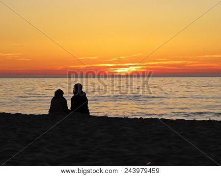 Couple In Love On A Sand Beach Seaside During Romantic Sunset