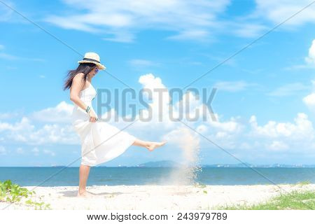 Smiling Asian Woman White Wearing Fashion Summer Walking On The Sandy Ocean Beach.  Woman Enjoy And
