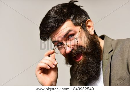 Happy Hipster With Long Beard And Mustache On Unshaven Face. Businessman Smile In Suit. Bearded Man