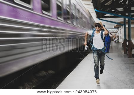 Tourist with bag running behind the train, A man runs for a moving wagon, Backpacker hurries for train departing from the station, Journey to the last minute poster