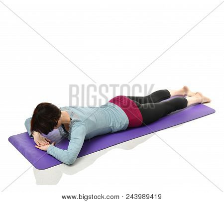 Mother Woman Exercising Doing Postnatal Workout. Female Fitness Instructor Stretching Hands And Legs