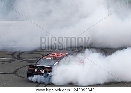 June 03, 2018 - Long Pond, Pennsylvania, USA: Martin Truex, Jr (78) celebrates after winning the Pocono 400 at Pocono Raceway in Long Pond, Pennsylvania.