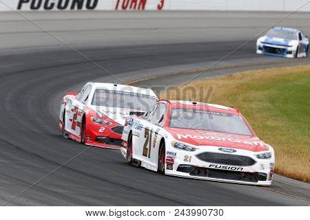 June 03, 2018 - Long Pond, Pennsylvania, USA: Paul Menard (21) battles for position during the Pocono 400 at Pocono Raceway in Long Pond, Pennsylvania.