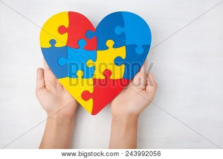 World Autism Awareness Day, Mental Health Care Concept With Puzzle Or Jigsaw Pattern On Heart With C