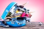 Blue Overloaded Trunk Different Things Accessories Clothes Towels Passport Bikini Tickets Coat Hanger Concept Summer Holiday Travel Preparation Trip Background Isolated Pink poster
