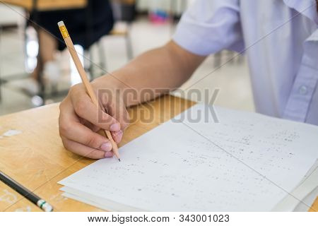 Hand Student Testing In Exercise Taking Fill In Exam Carbon Paper Answer Sheet With Pencil At School