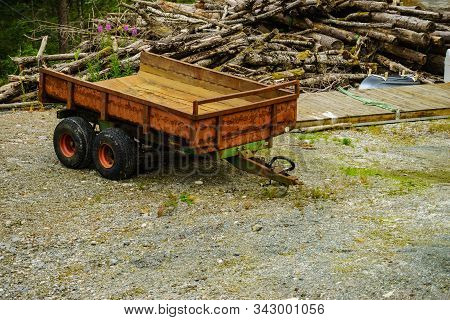 Forestry Machine Trailer Truck And Wood Logs. Harvest Of Timber. Firewood As Renewable Energy Source