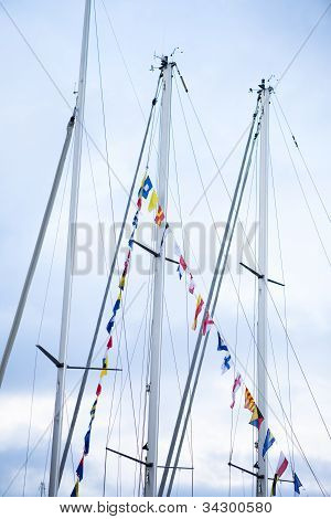 Sail Boat Masts Decorated With Flags