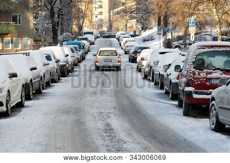Solna, Sweden - December 10, 2019: View Of The Urban Snow Covered Virebergsvagen Street With Traffic